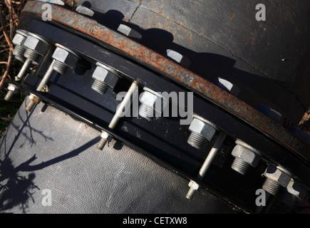 Nuts, bolts, and washers on land drainage pipe at Hardley, Norfolk, England, United Kingdom. - Stock Photo