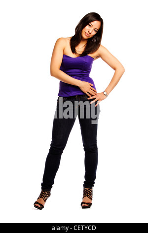 Confident young asian woman standing on isolated white background - Stock Photo