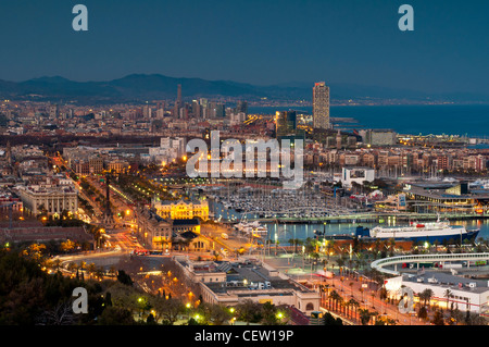 Panoramic view at sunset from Montjuic over Port Vell, Barcelona, Catalonia, Spain - Stock Photo