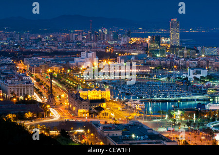 Panoramic view at night from Montjuic over Port Vell, Barcelona, Catalonia, Spain - Stock Photo