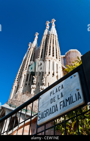 Day view of the Passion facade with placa de la sagrada familia sign, Sagrada Família church, Barcelona, Catalonia, - Stock Photo