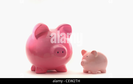 LARGE AND SMALL PIGGYBANKS RE FINANCIAL GROWTH SAVINGS THE ECONOMY BUDGETS LOANS CREDIT MONEY CASH INCOMES BANKS - Stock Photo