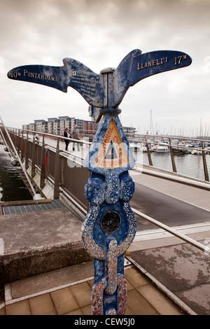 UK, Wales, Swansea, Maritime Quarter, National Cycle Network sign sailbridge over River Tawe, - Stock Photo