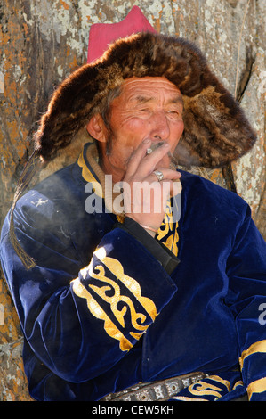 portrait of a Kazakh eagle hunter in the Altai Region of Bayan-Ölgii in Western Mongolia - Stock Photo