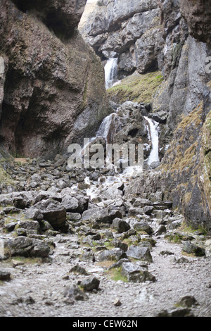 The waterfall on Gordale Beck at the base of Gordale Scar in the Yorkshire Dales - Stock Photo