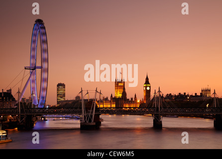 The view along the River Thames of the Millennium Wheel (London Eye), Houses of Parliament and Big Ben at sunset, - Stock Photo