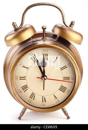 Alarm clock isolated on white background. It's five minutes to twelve p.m. - Stock Photo