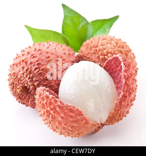 Lychee with leaves on a white background. - Stock Photo