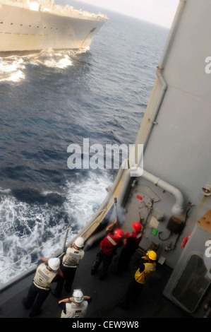 GULF OF THAILAND (Feb 20, 2012)- Seaman Derrick Yoder fires a phone line towards the USNS Tippecanoe (T-AO-199) - Stock Photo