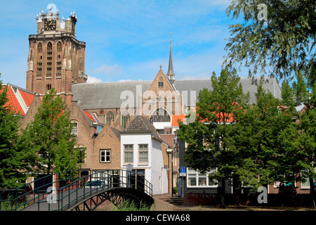 Dordrecht cathedral towering above the houses with a footbridge in the foreground - Stock Photo