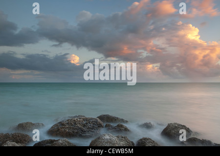 Rocky shoreline at sunset in Key West, Florida, USA - Stock Photo