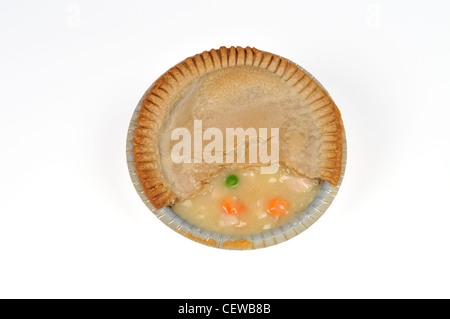 Cooked Chicken pot pie with piece of top crust removed in aluminum tin on white background cut out. - Stock Photo