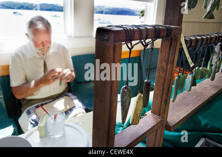 An artist during greenstone carvings at the bay of Islands in Northland New Zealand. - Stock Photo