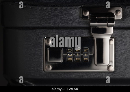 Briefcase Abstract with the Numbers 911 on Lock. - Stock Photo