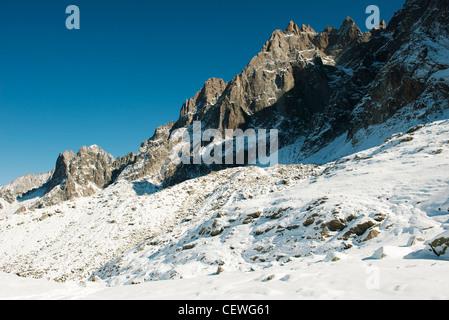 Snowy mountain peaks against clear sky - Stock Photo