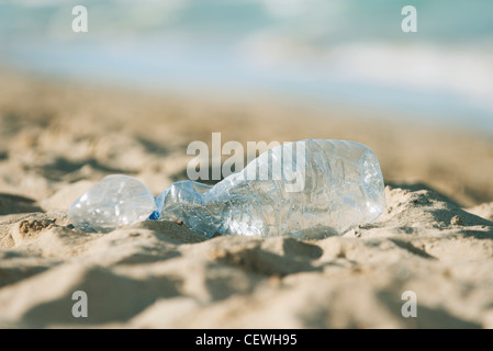 Empty plastic bottle on beach, selective focus - Stock Photo