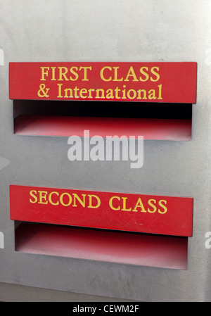 First Class and International and Second Class posting boxes close up. - Stock Photo