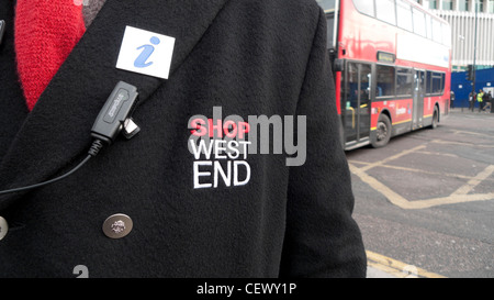 Close-up of Shop West End Information Officer emblem on employee's coat Tottenham Court Road and Oxford Street, - Stock Photo