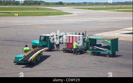Baggage Handlers at Ministro Pistarini Airport, Buenos Aires, Argentina - Stock Photo