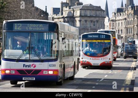 Busses on Princes Street, Edinburgh Scotland. - Stock Photo
