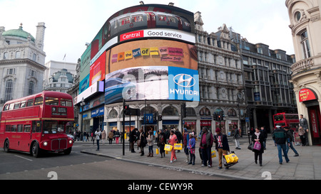 Shoppers and number 9 London double decker bus at traffic lights Picadilly Circus London England UK  KATHY DEWITT - Stock Photo