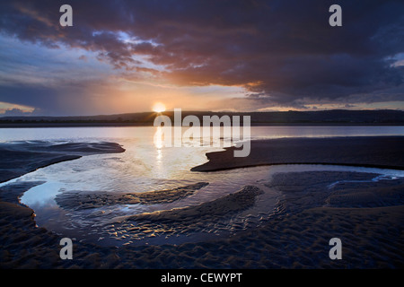 Sunset over mudflats of the River Severn at sunset. - Stock Photo