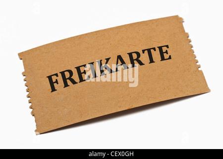 Detailansicht einer Karte aus Papier mit der Aufschrift Freikarte | Detail photo of a paper card with the inscription - Stock Photo
