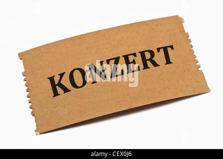 Detailansicht einer Karte aus Papier mit der Aufschrift Konzert | Detail photo of a paper card with the inscription - Stock Photo