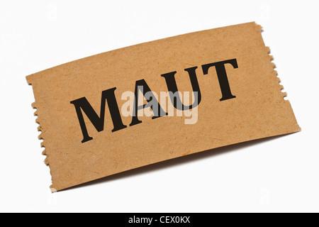 Detailansicht einer Karte aus Papier mit der Aufschrift Maut | Detail photo of a paper card with the inscription - Stock Photo
