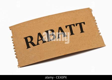 Detailansicht einer Karte aus Papier mit der Aufschrift Rabatt | Detail photo of a paper card with the inscription - Stock Photo