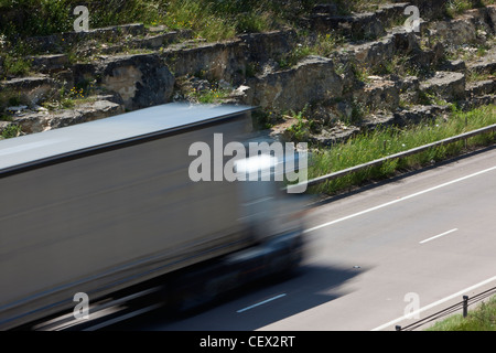 A lorry travelling on the A417 dual carriageway. - Stock Photo