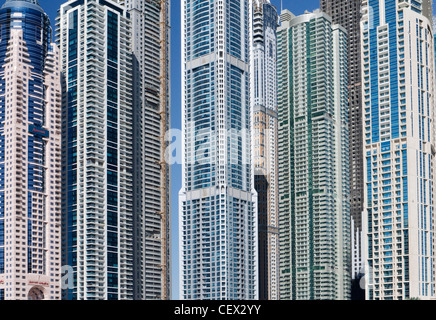 View of modern high-rise apartment buildings in Marina at New Dubai in United Arab Emirates - Stock Photo