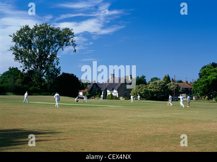 A Sunday afternoon cricket match in the village of Elmley Castle. - Stock Photo