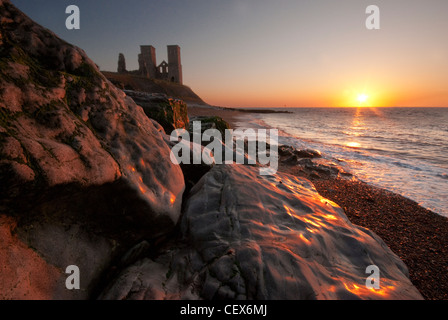 The Reculver Towers at sunset on the north coast of kent - Stock Photo
