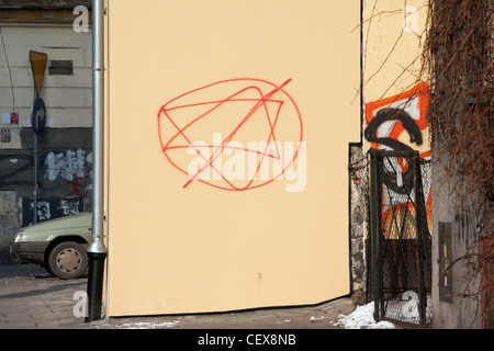 Anti-semitic graffiti on a wall in the Jewish Quarter of Kazimierz in the city of Krakow in Poland. - Stock Photo
