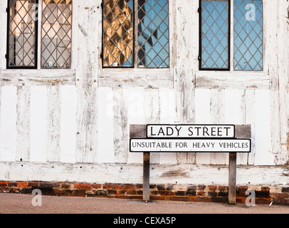 Street name and a road sign outside an old building in Lavenham, Suffolk, UK - Stock Photo