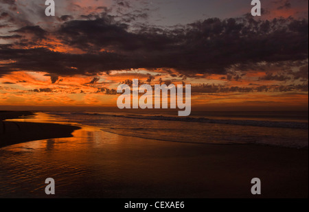 Colorful clouds accent the sunrise on Mexico's Pacific Coast, Acapulco, Mexico. - Stock Photo