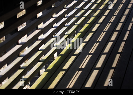Wooden fence and shadow - Stock Photo
