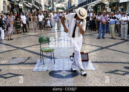 Street Performer on Rua Augusta Street, Lisbon, Portugal - Stock Photo