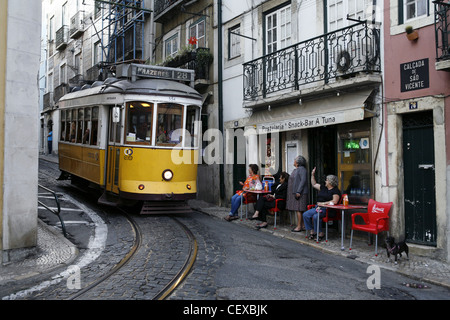 Greeting the Driver of Tram No. 28 in Alfama, Lisbon, Portugal - Stock Photo