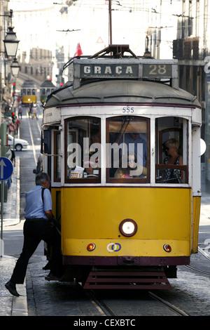 Tram No. 28 on Rua da Conceição Street, Lisbon, Portugal - Stock Photo