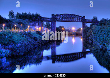 Dusk at the Manchester Ship Canal high level railway bridge A50 Cheshire lines Altrincham Trans Pennine Trail TPT - Stock Photo