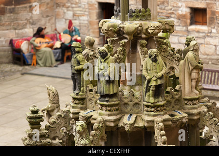 A fountain in the courtyard of the ruins of Linlithgow Palace in Scotland. The palace was home to kings and queens. - Stock Photo