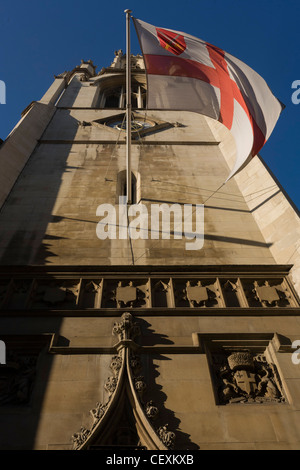 The cross of St George flies above ornate reliefs on the tower of St Dunstan-in-the-West church on Fleet Street. - Stock Photo
