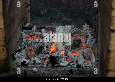 photo of the live coals at stove - Stock Photo