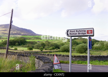 Road Sign Pointing to Pont Rufeinig Roman Bridge, in midst of Rural Scenic Landscape, Lledr Valley, Conwy, Wales, - Stock Photo