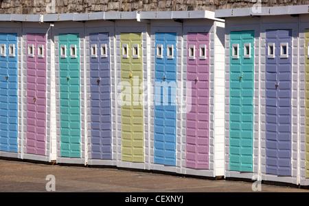 Beach Huts at Lyme Regis in Dorset - Stock Photo