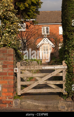 4 3 2 1 row of red rubber brick Victorian Terraced Cottages Eastbourne in early morning with worn entrance stone - Stock Photo