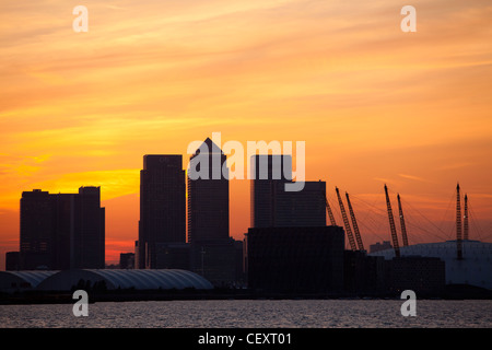 A view down th river Thames towards the City of London and the O2 Arena and Canary Wharf at sunset - Stock Photo