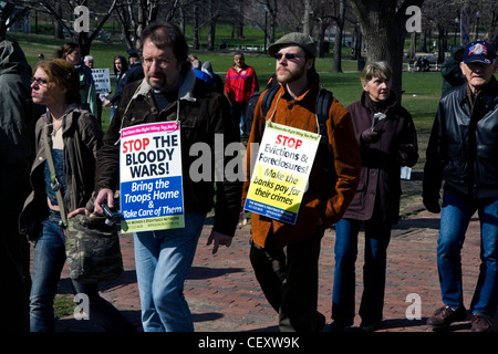Protesters in Boston against the government at 15 April 2011. Signs to Stop the war. - Stock Photo